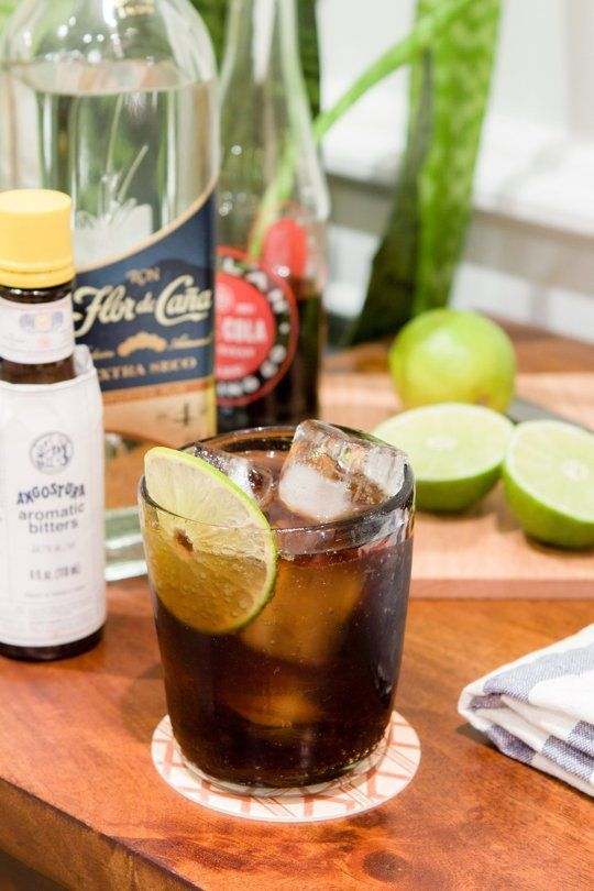 The Cuba Libre  Serves 1 2 ounces light rum Juice from half a lime 4 dashes Angostura bitters Cane cola Lime wheel