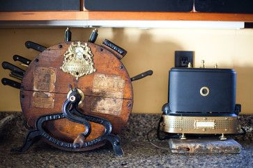 """A late-19th-century knife sharpener became a knife holder, while beside it a 1930s Toast-O-Lator"""" was steampunked with brass and repurposed objects."""