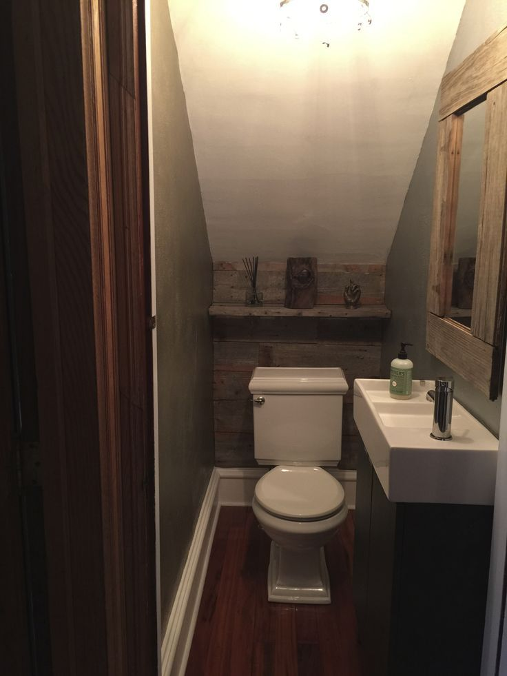 image result for shower under stairs