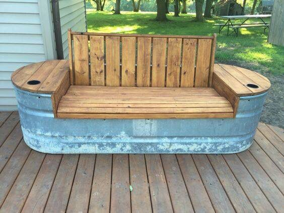 An old stock tank & salvaged lumber (maybe doors?) = cute outdoor bench!