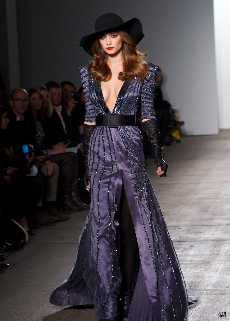 There is something so kick ass about this purple gown, that I feel like if one was to wear it, they would own every room they entered. The plunging neckline is fab, the pattern and colour is ideal. A genuine winning dress.