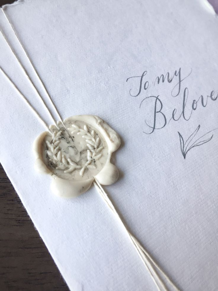 Imperfect White Wax Seal on Vows Booklet // Bridal Veil Falls Style Shoot