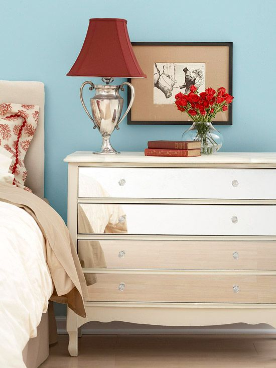 Make your own mirror-covered furniture for a fraction of the cost of this glam home decor trend. Find a dresser, desk, or table with drawers from a thrift store, and freshen it up with a coat of paint. Have a hardware store cut mirrors that fit the drawer fronts and drill holes for hardware, then attach them with mirror glue. Tip: Pay extra for polished edges if kids will be using it.