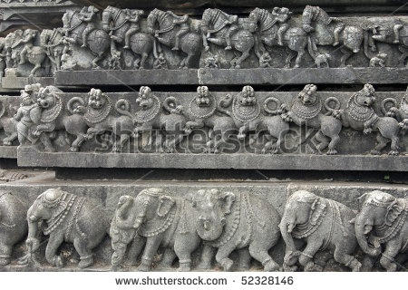 layered carvings around the famous ancient belur temple in karnataka state, india. Construction of the Chenna Keshava Hindu temple began in 1116 AD, and took more than 100 years to complete.  Image ID: 52328146