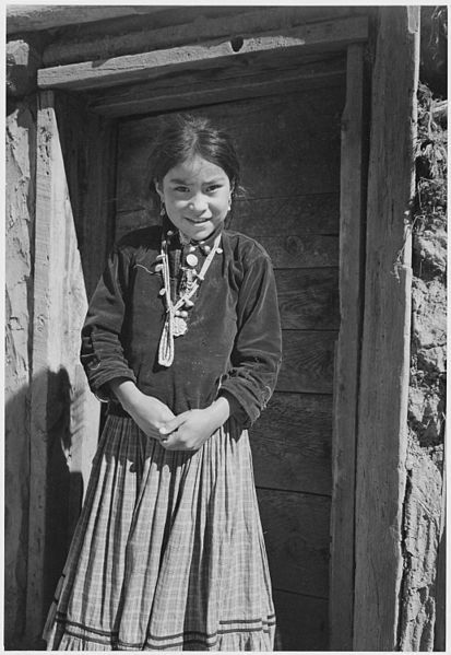 """Diné Girl, Canyon de Chelle, Arizona."" Canyon de Chelly National Monument, 1933 -1942, Ansel Adams, public domain via Wikimedia Commons."