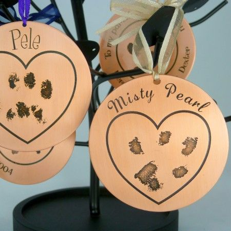 Put that precious pet's signature in your heart forever! We hand etch your pet's paw print onto a beautiful copper medallion - Simple, lovely, and a unique keepsake anyone would love.