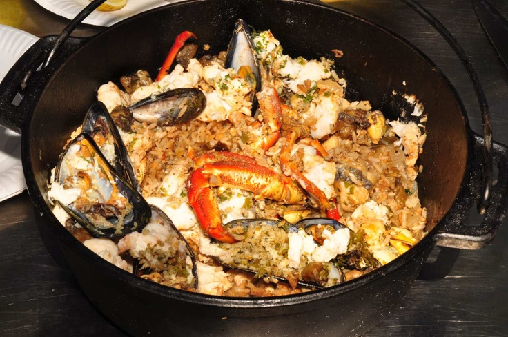 Potjie kos (casserole) seafood dish with mussels and crayfish as main ingredients