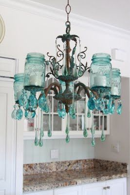This is an amazing idea if you have a chandelier that has faulty wiring...turn it into a candelier! The color is gorgeous, and I like the quirky use of the jars. Via Shabbyfufu blog.