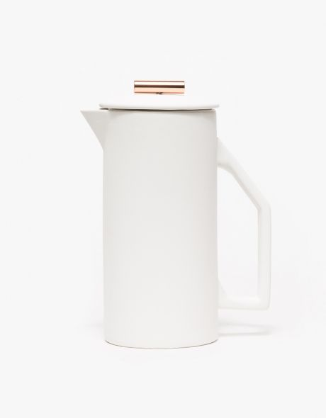 From Yield Design, a heavy walled ceramic French Press. Featuring a ceramic body to maintain temperature throughout the brewing process, a copper bar handle, a fine mesh steel filter, a matte ceramic exterior, and a stainless high gloss interior that is c