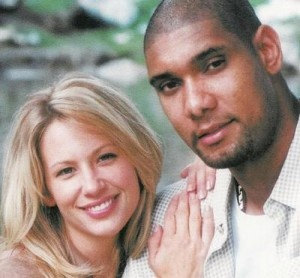 Tim Duncan with his wife, Amy. I hate my life! :( why can't I meet any handsome, quiet and sweet men who play for my favorite NBA team? Because he's married :(
