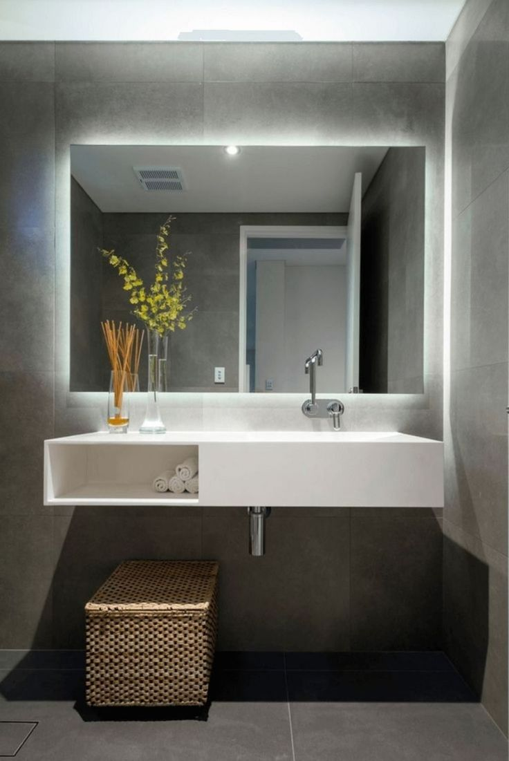 Minimalist Bathroom With Lighted Mirror Choosing The Right Bathroom Vanity Mirrors Check more at http://www.wearefound.com/choosing-the-right-bathroom-vanity-mirrors/