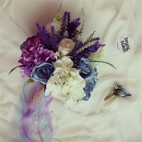 Mavi-Mor Ortancalı Gelin Çiçeği (BKT017)    Mavi-Mor Ortancalı Gelin Çiçeği  Göz alıcı gelin çiçeğinde mavi,mor ve beyazın muhteşem uyumu  Favorilere Ekle  İstek Listeme Ekle Fiyat Düşünce Haber Ver Gelince Haber Ver  Gelin buketimiz 1. kalite yapay çiçeklerle tasarlanmıştır.  Buketimizde gül, ortanca , lavanta,leylak ve tomurcuk kullanılmıştır.  *Damat yaka çiçeği hediyemizdir.