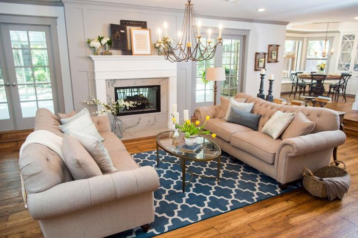 Other enhancements include new crown molding, baseboards, a pass-through fireplace and a showpiece chandelier.