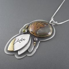 Wow statement pendant with yellow gold, rustic diamonds, silver and rare plume agate. Handmade art jewelry by Beth Millner Jewelry