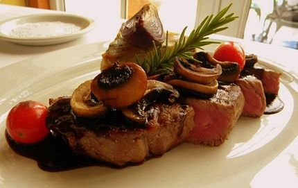 Grilled sirloin with potato galette, roasted red onions, baked tomato and chasseur sauce
