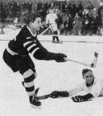 """Rudi Ball playing for Berliner SC in the Spengler Cup tournament against Cambridge University, Davos, Switzerland, December 31, 1931.Born to a middle class family in Berlin, Rudi Ball's father and paternal ancestors were Jewish, and his mother was from a Lutheran family. Considered a """"half-Jew"""" according to Aryan laws, Rudi Ball was initially not allowed to compete for the German hockey team at the 1936 Winter Olympic Games. However, his friend and star teammate Gustav Jaenecke refused…"""
