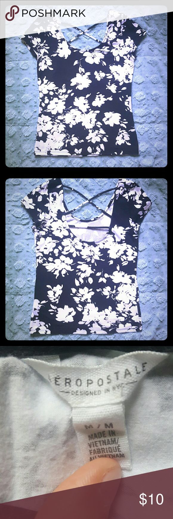 Aeropostale Strappyback Bodycon Top Aeropostale Strappyback Bodycon Top. It is a cute black and white floral pattern. This shows some wear in the color from washes but is still in good condition. It is a tight Bodycon fit and is short but not quite a crop top. Make an Offer! Aeropostale Tops Crop Tops