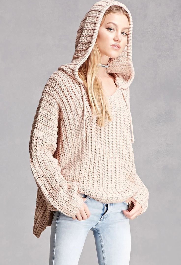 An oversized soft ribbed sweater featuring long dolman sleeves, a drawstring hood, side slits, and a flowy silhouette. This is an independent brand and not a Forever 21 branded item.