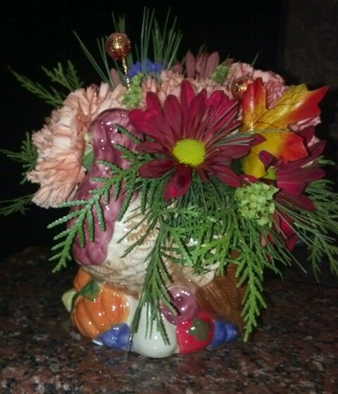 Floral design by Flowers and Fascinations in a Thanksgiving ceramic turkey thrift store find.