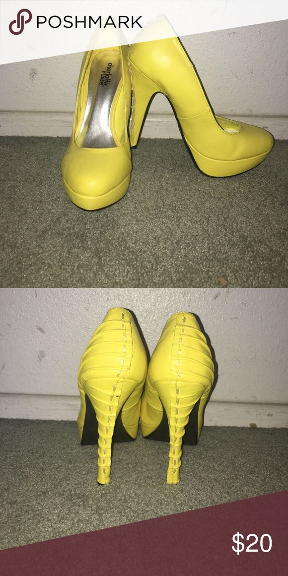 Yellow high heels from Charlotte Russe. Shoes have been worn maybe twice. A couple of scuff marks but the bottoms show little wear. Charlotte Russe Shoes Heels