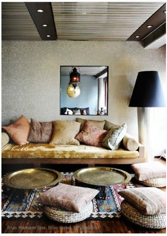 Moroccan style comfy living room. We really need the brass tea tables, the beautiful Kelim rug and all the cushions in the world!