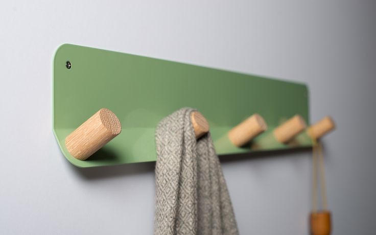"Plane is a minimally designed wall hook that adds function, refinement and warmth to any room. The bent, laser-cut steel mounts flush to the wall and supports 1, 3 or 5 angled wooden pegs. Unlike the thin metal coat hooks on the market, the 1"" thick woode…"