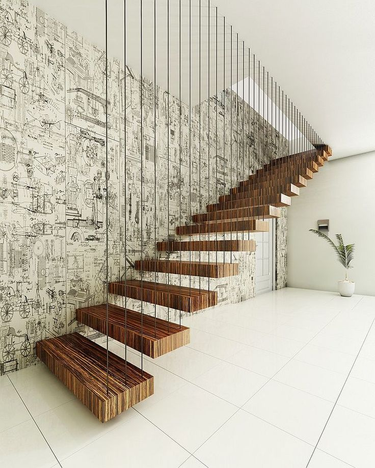 Dramatic Floating Staircase With A Backdrop To Match Its Brilliance