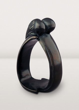 True love lasts forever. An embracing couple shares infinite love in this elegant black kisii soapstone sculpture. A perfect wedding or anniversary gift.