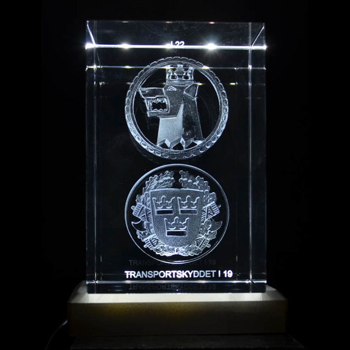 A crystal block engraved in 2D. In terms of logos, it's usually doesn't work engrave in 3D, but it can be done with a certain depth and in combination with an LED lamp, it will stil be al very good and nice crystal blocks. Here I19 swedish army