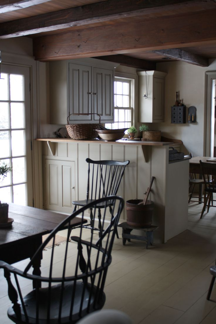 love the muted hues and wood beams. very elegant country kitchen.