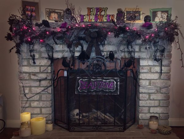cover tile on fireplace with stone wall covering for halloween