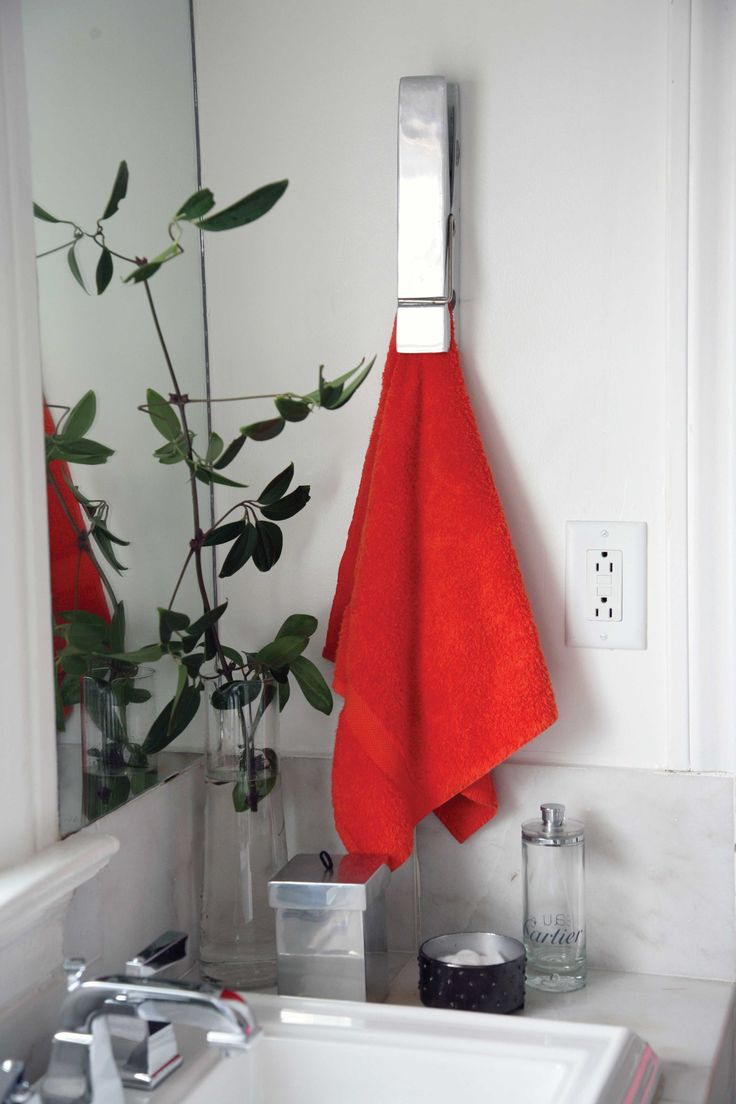 Our modern Clothespin at work! Shop the modern and fun Nima Oberoi Lunares and use it as a towel holder/hanger or as paper clips.