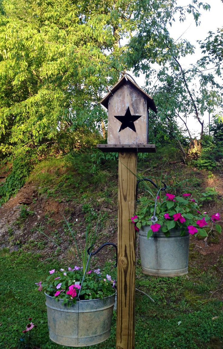 Rustic Birdhouse on pole with hanging bucket flower planters.....                                                                                                                                                      More