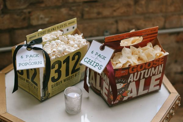 Six-packs aren't just for beer. Debi Lilly of A Perfect Eventused local craft brew carriers to serve savory snacks like chips and popcorn during cocktail hour and the after party.Related: 7 Unique Ways to Display Your Wedding Food
