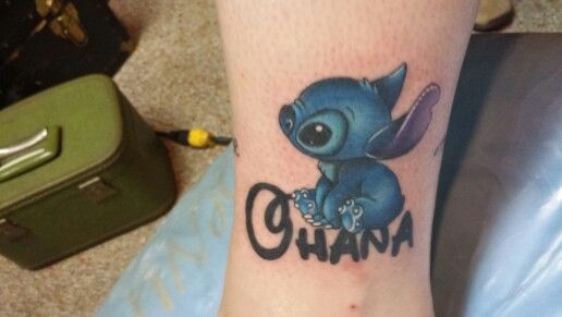 My Stitch Ohana tattoo. My family's handwriting of the word love circles around my ankle!