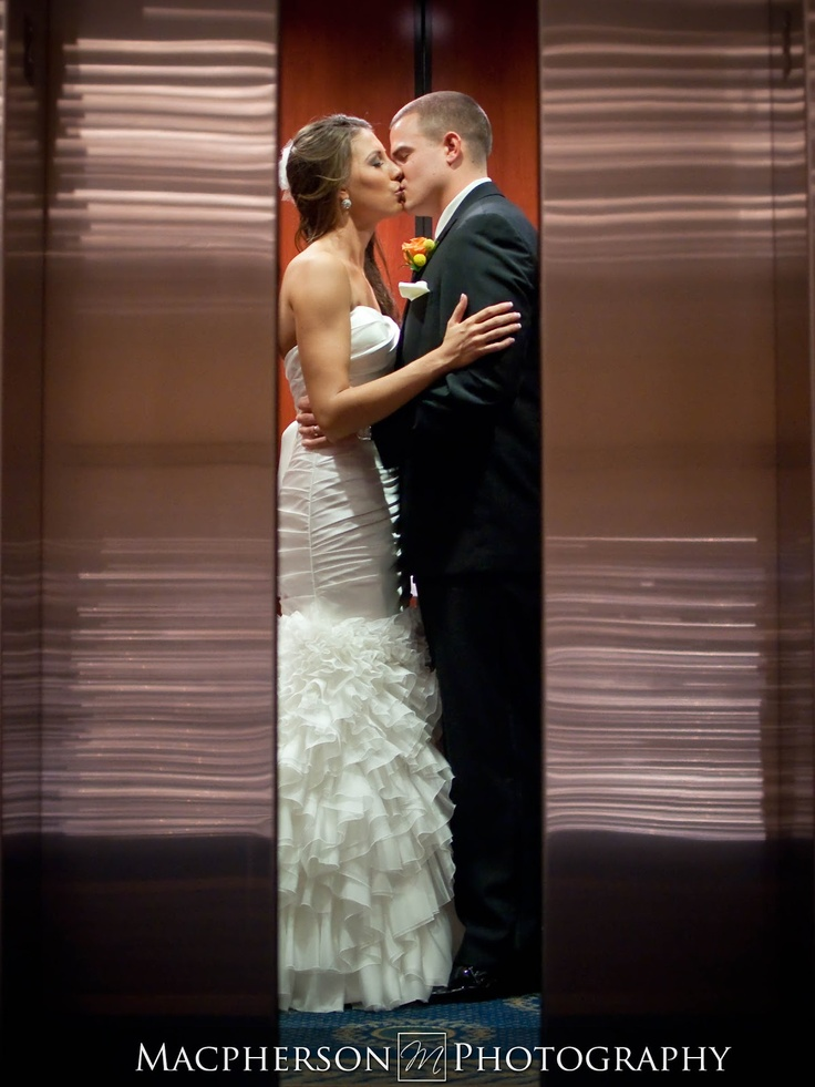 awesome elevator steal a kiss shot for Wedding