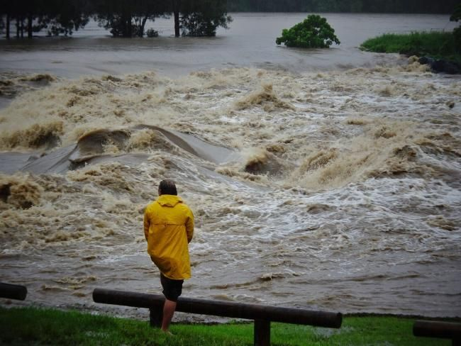 A causeway overflows in the Gold Coast suburb of Oxenford. Picture: Brett Faulkner