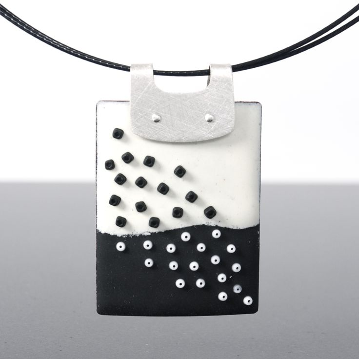 Black and white pendant with a fun scattering of beads that spread diagonally from top to bottom. The texture on this piece is fantastic - a rich, matte surface with raised beads is definitely different, and striking! This is a versatile piece and is a wonderful choice if you want to mix with all sorts of earrings and outfits. The black double-strand cable necklace can be adjusted in length, so it will sit *just* where you want it to. This piece my signature velvety, matte surface quality…