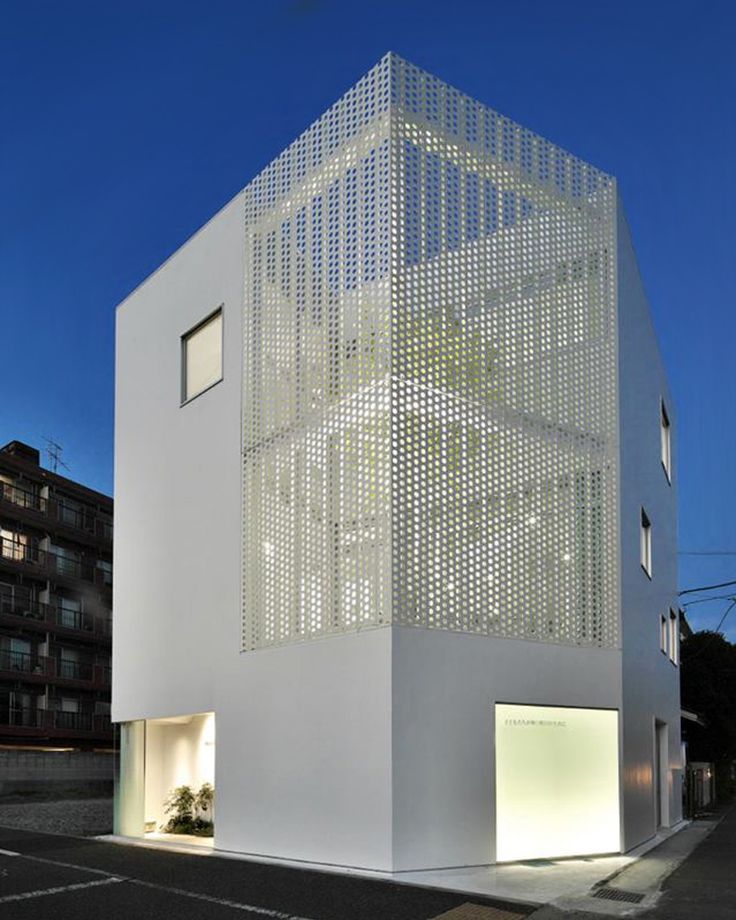 within the scheme, a garden featuring planted trees is enclosed with a perforated metal screen that ensures privacy.