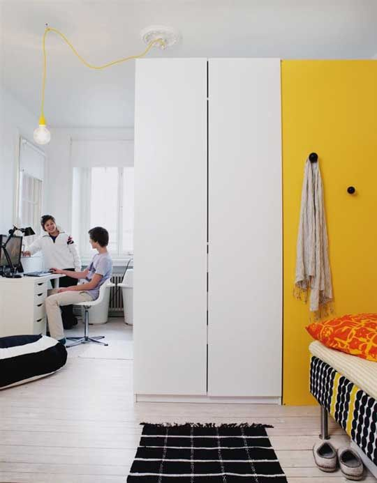 a tall wardrobe as room divider for two teen boys