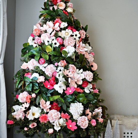 Faux Flowers and lots of them + Magnolia Leaves = Unique Pretty Christmas Tree