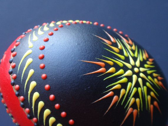 Easter Egg Pysanka in Black Red and Yellow Hand by EggstrArt