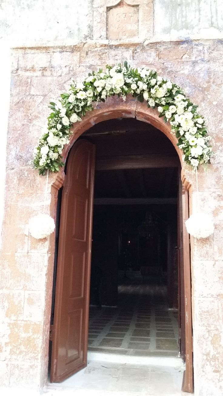 Wildflower white and green, wedding arch for, church door decoration for wedding at stone church in Plagia Greece by Gourioti Flowers