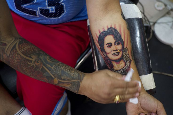 Aung san suu kyi supporters get tattoos of her face