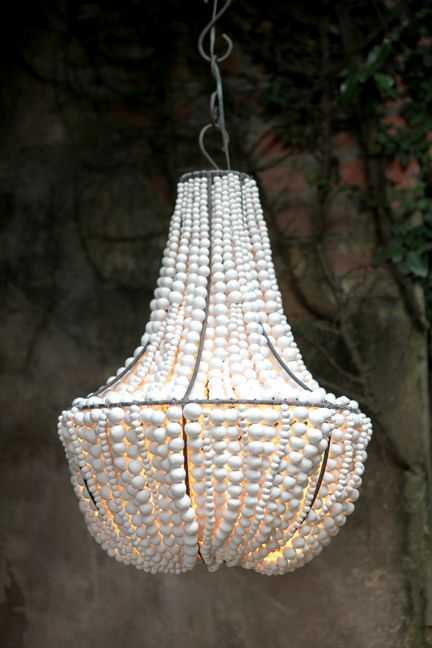 Made by Hellooow Handmade chandeliers. Recycled paper and clay beads