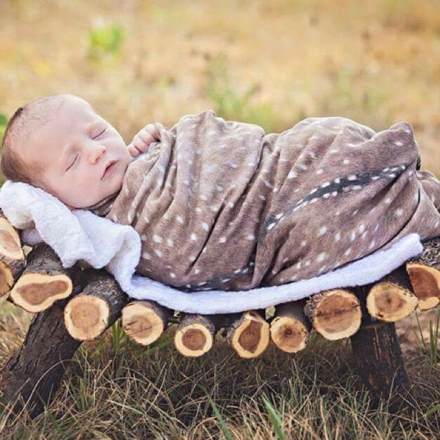 Rustic deer skin swaddle blanket for newborns or infants. It is super soft to the touch and the perfect blanket to cuddle with. The pattern is printed on the fabric and looks just like a little fawn.