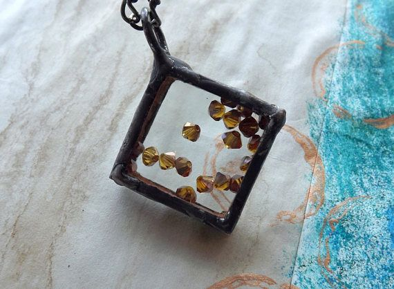 Square pendant with dark gold crystals.Tiffany