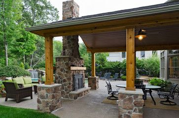 Covered patio with fireplace, with the brick matching what's already on the home