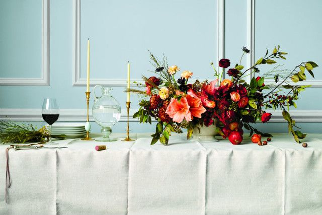horizontal centerpiece - amaryllis, autumn branches, ranunculus, mums, roses Just the right shape for dining