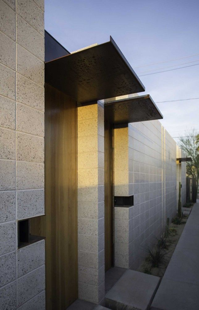 simple metal door canopy | White Stone Studios / Benjamin Hall Design